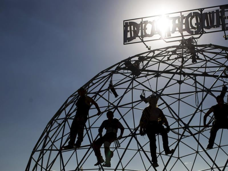 People climb on the Thunderdome as they watch a performance during the Wasteland Weekend event in California City, California September 26, 2015. The four-day event has a post-apocalyptic theme and is inspired by the Mad Max movie franchise. (REUTERS)