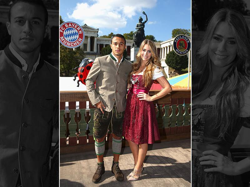 Spanish footballer Thiago of FC Bayern Munich and his partner Julia Vigas pose during their visit at the Oktoberfest in Munich, Germany.  (Reuters Photo)