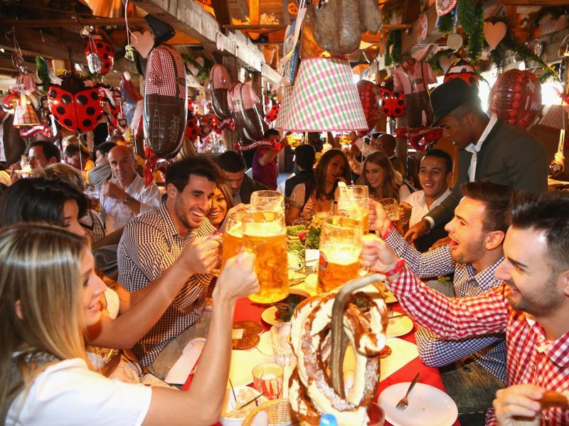 German club Bayern Munich's players toast as they visit the Oktoberfest beer festival 2015 at Theresienwiese in Munich, southern Germany. (AP Photo)