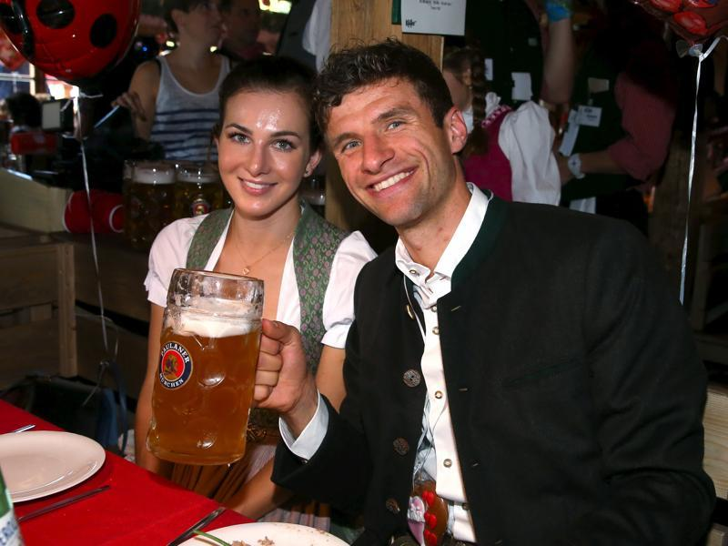 Bayern Munich forward Thomas Mueller and his partner Lisa pose at the Oktoberfest in Munich, Germany.  (Reuters Photo)