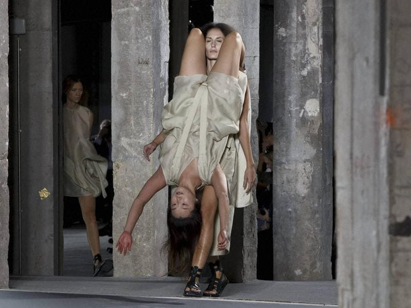 Models as backpacks and knapsacks: When American designer Rick Owens showcased his creations at the Paris Fashion Week, the strapped up models left the audience shocked. (AP)