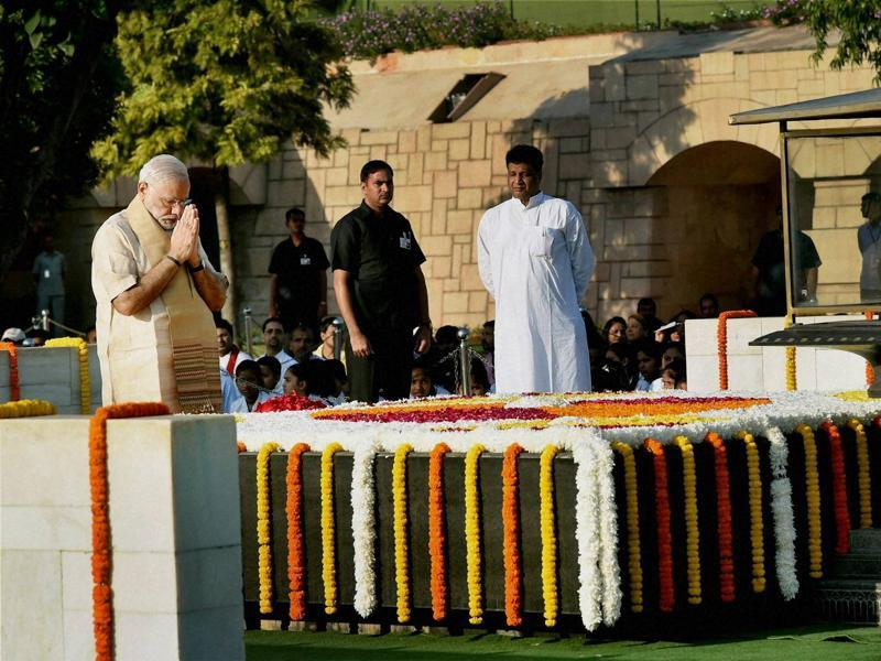 Prime Minister Narendra Modi pays tributes at Rajghat, Mahatma Gandhi's memorial, on his 146th birth anniversary, in New Delhi on Friday.  (PTI Photo)