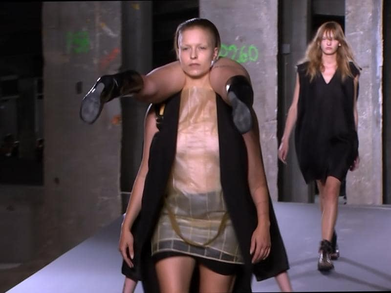In this image taken from video, a model carries another model on the runway as part of American designer Rick Owens' Spring-Summer 2016 ready-to-wear fashion collection, presented during the Paris Fashion Week. (AP)