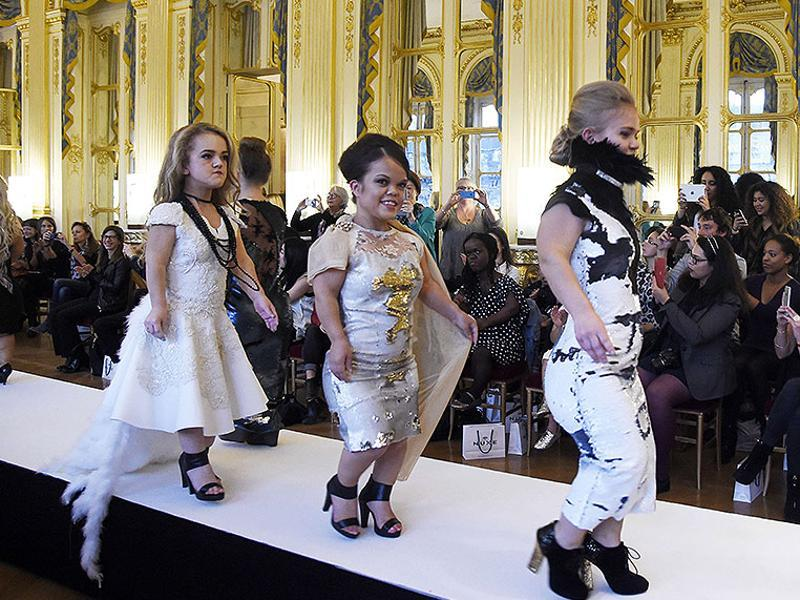 Models present creations during the National Dwarf Fashion Show on October 2, 2015 during in Paris.  (AFP)