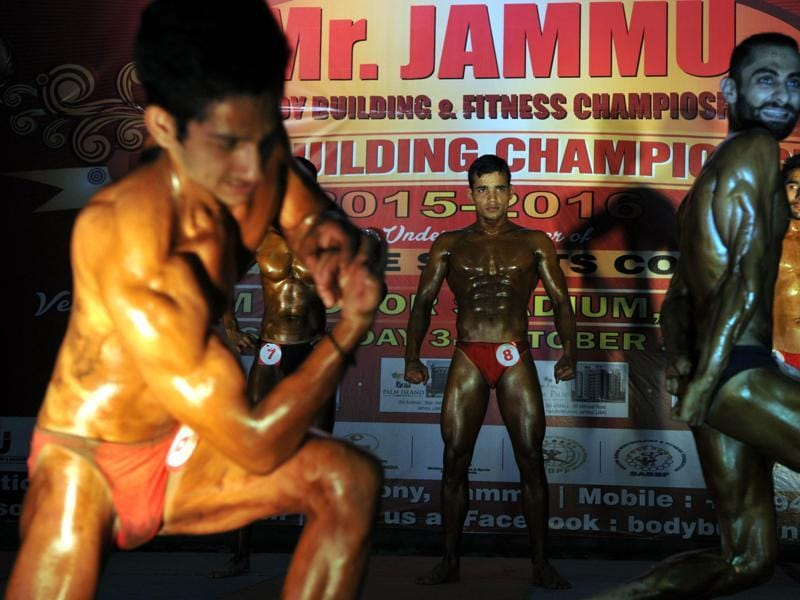 Body-builders pose during the 'Mr. Jammu Body Building Competition' in Jammu.  (Nitin Kanotra / HT)