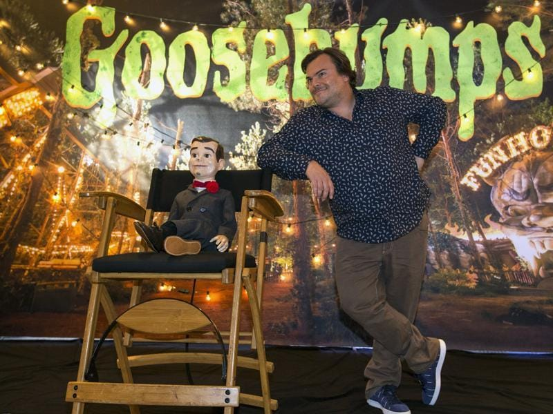 Jack Black poses next to Slappy the Dummy during a photo call for Goosebumps. (REUTERS)