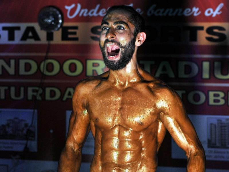 A body-builders shouts after his selection in the first round during the 'Mr. Jammu Body Building Competition'. (Nitin Kanotra / HT)