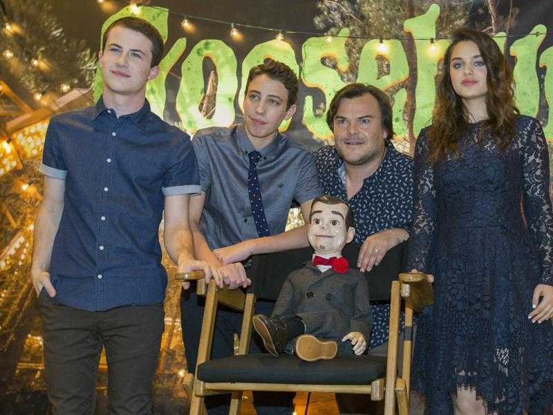 Cast members Jack Black, Dylan Minnette (L), Ryan Lee and Odeya Rush pose next to Slappy the Dummy during a photo call for Goosebumps. (REUTERS)