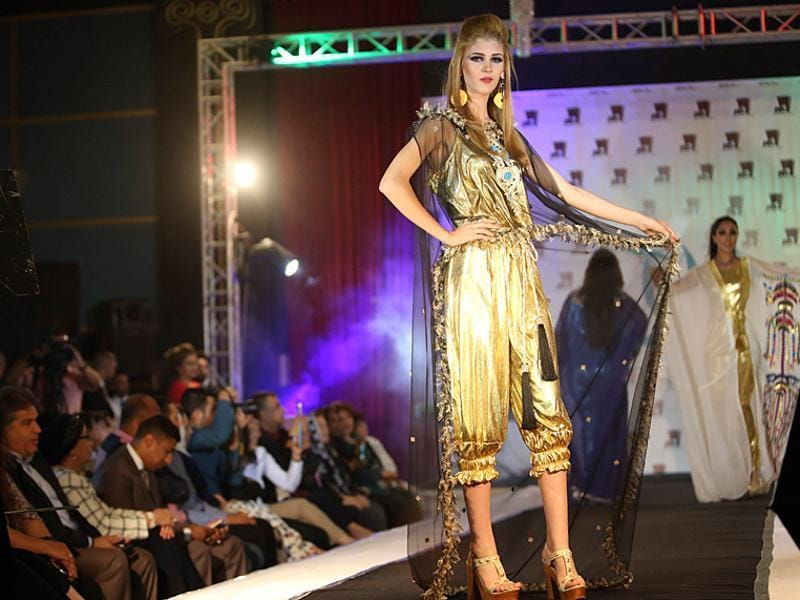 Simmer and gold: Models display dresses designed by Iraqi designer Ziad Tariq in Basra. (AP)