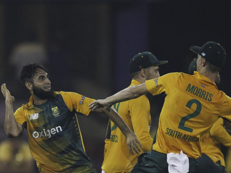 South Africa's Imran Tahir, left celebrates the wicket of India's Suresh Raina with teammate Chris Morris. (AP Photo)