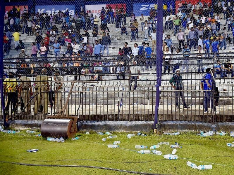 Water bottles thrown by the crowd are seen lying on the ground. (PTI Photo)