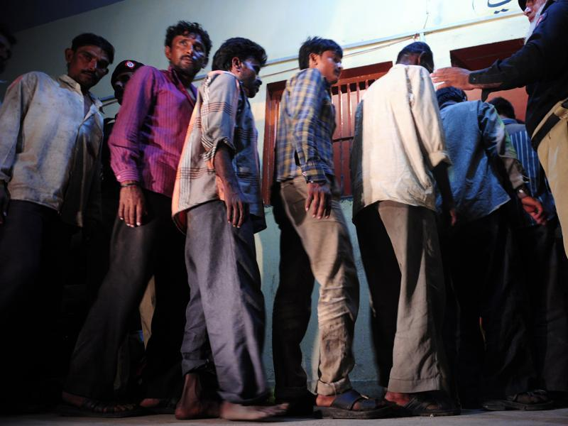 Arrested Indian fishermen being paraded at a police lock up in Karachi. (AFP)