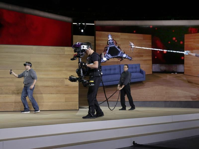 Microsoft demonstrates its upcoming HoloLens augmented reality device by showing a
