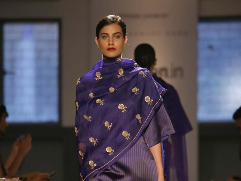 A model showcasing intrigue embroidery creations by fashion designer Sanjay Garg. (IANS)