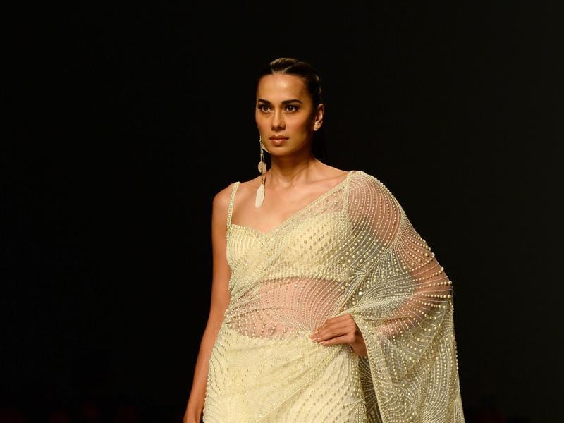 Subtle cream saree, embellished in pearl by fashion designers Rabani and Rakha.  (AFP)