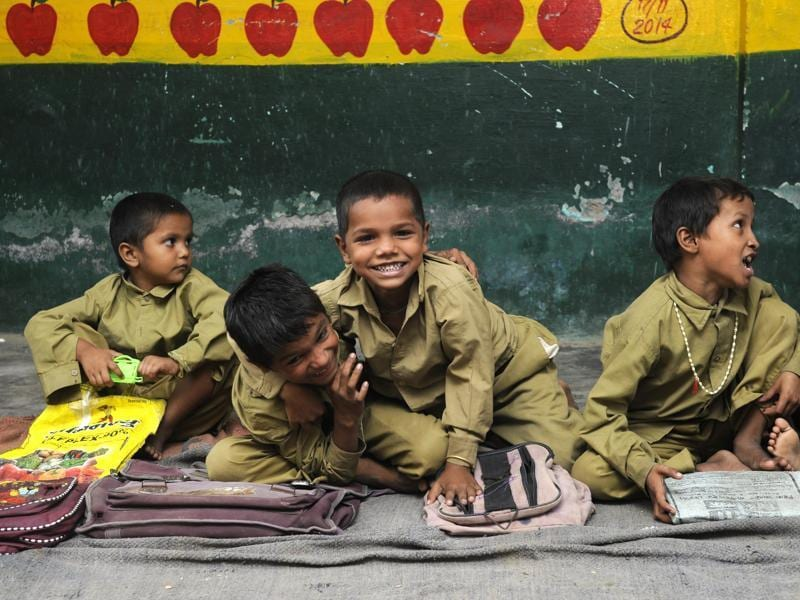 Children at a primary school in Dadri area have a good time. (Sunil Ghosh / HT Photo)