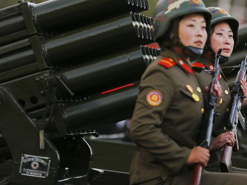 A soldier (R) cries as her vehicle with rocket launchers drives past a stand with North Korean leader Kim Jong Un during a parade celebrating the 70th anniversary of the founding of the ruling Workers' Party of Korea, in Pyongyang.  (REUTERS)