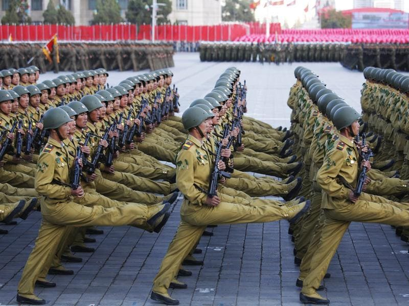 North Korean soldiers in historic uniforms march during a parade on the Kim Il Sung Square. North Korean leader Kim Jong Un declared on Saturday that his country was ready to stand up to any threat posed by the United States as he spoke at a lavish military parade. (AP)
