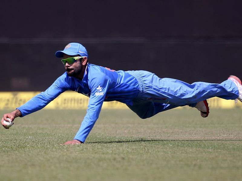 India's Virat Kohli dives to stop a ball during South Africa's innings. (Reuters Photo)