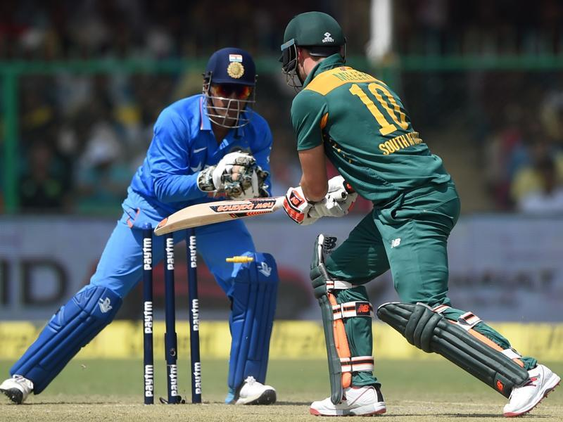 Dhoni stumps South Africa's David Miller off the bowling of Amit Mishra. (AFP Photo)