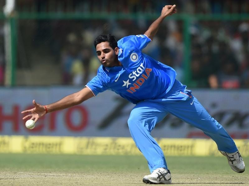 India's Bhuvneshwar Kumar fields off his own bowling during the first innings.  (AFP Photo)