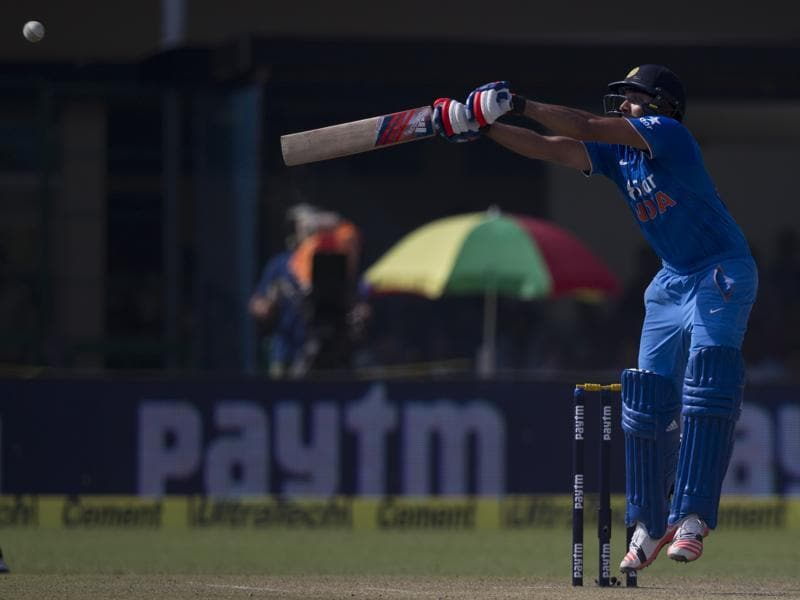 Rohit Sharma plays a shot during India's chase. (AP Photo)