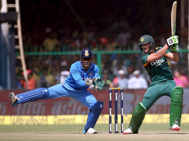 South Africa's Faf du Plessis plays a shot as Dhoni watches. (Reuters Photo)
