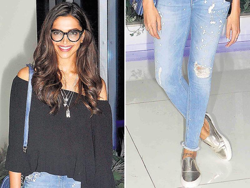 Deepika Padukone parading in silver loafers with distressed denims. (yogen shah/HT)