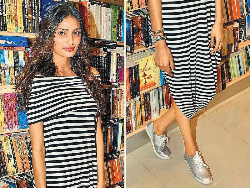 Athiya Shetty wears metallic sneakers with a striped dress. (yogen shah/HT)