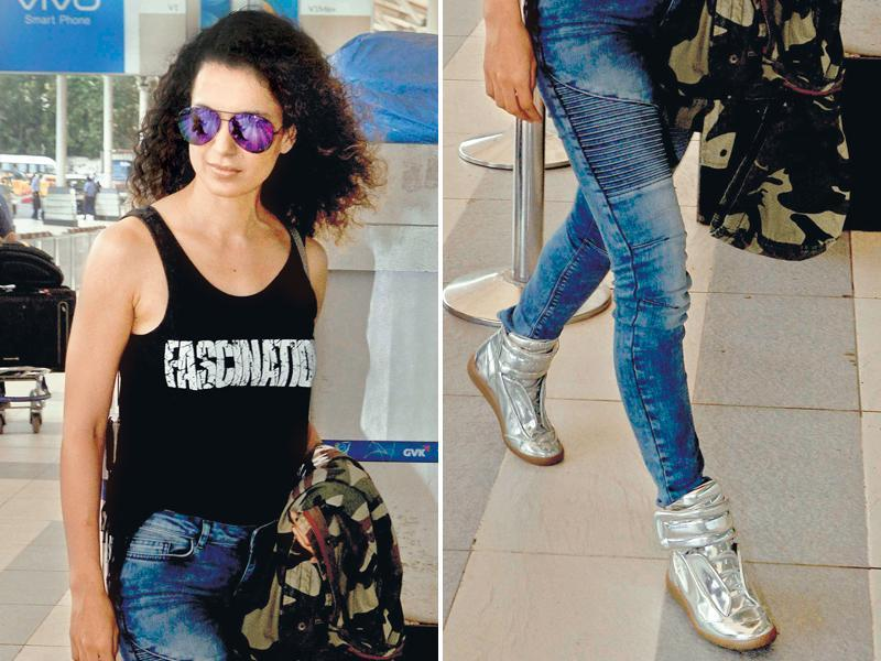 Kangana Ranaut pairs her  lacy sports shoes with skinny denims. (yogen shah/HT)
