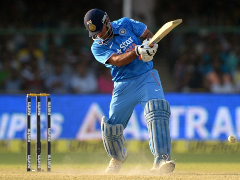 India's captain Mahendra Singh Dhoni plays a shot during the first ODI against South Africa at Green Park Stadium in Kanpur, on October 11, 2015. (AFP Photo)