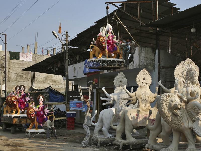 Workers bring an idol of Durga for Navratri celebrations  in Hyderabad.  (AP)