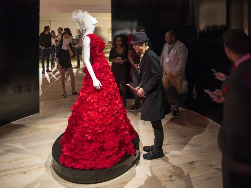 This October 2015 photo provided by the SCAD FASH museum shows a red gown designed by Oscar de la Renta forBeyonce, on display at the museum on the Atlanta campus of the Savannah College of Art and Design. (AP)
