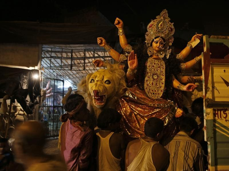 Laborers load an idol of Durga onto a truck ahead of Navratri in Allahabad. (AP)