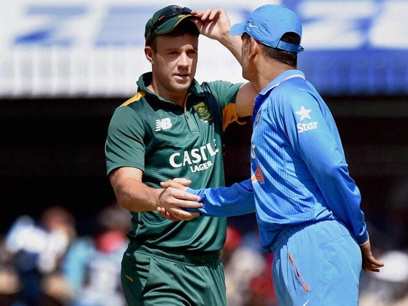 Indian captain MS Dhoni shakes hands with South African captain AB de Villiers during the toss. (PTI Photo)