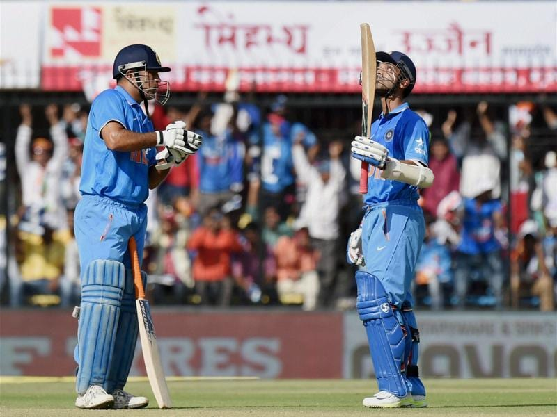 Ajinkya Rahane celebrates his half century with MS Dhoni. ) (PTI Photo)