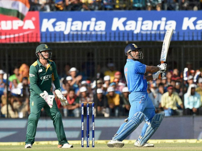 India's Mahendra Singh Dhoni hits a six during the second ODI against South Africa at Holkar Cricket Stadium in Indore, on October 14, 2015.  (PTI Photo)