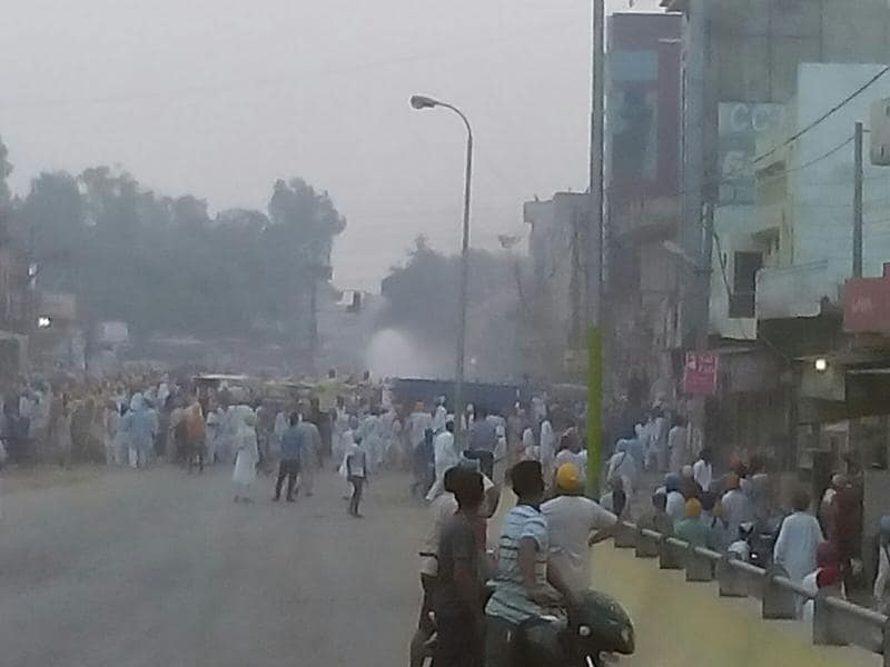 Police used batons and water cannons to disperse protesters in Kotkapura town of Faridkot district. (Sanjeev Kumar/HT Photo)