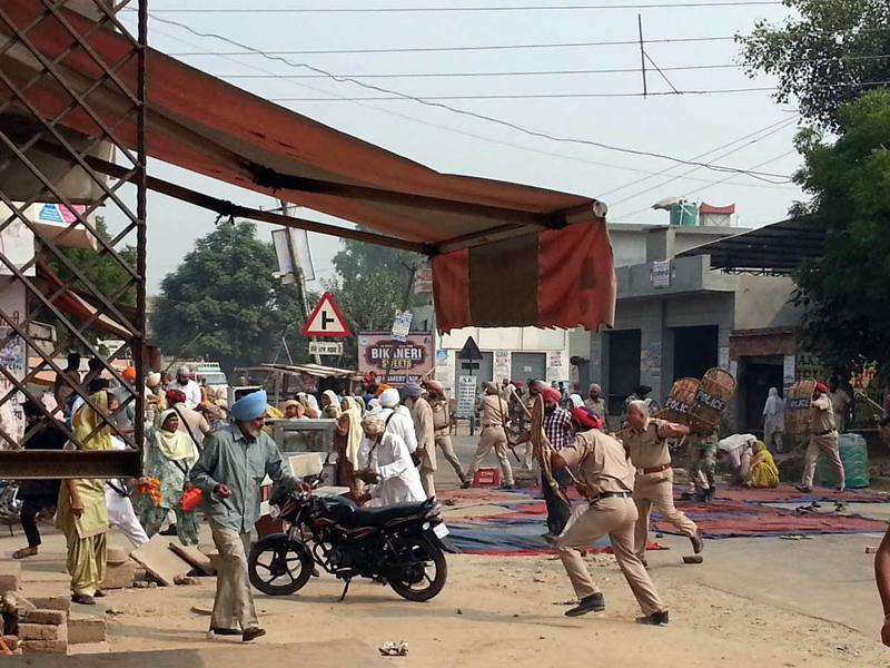 Police used batons and water cannons and fired in the air to disperse members of Sikh groups who gathered in Kotkapura town of Faridkot district early on Wednesday to protest the act of sacrilege in Bargari village.  (Sanjeev Kumar/ Ht Photo)