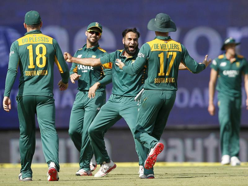 South Africa's Imran Tahir, centre, celebrates the dismissal of Ajinkya Rahane. (Reuters Photo)