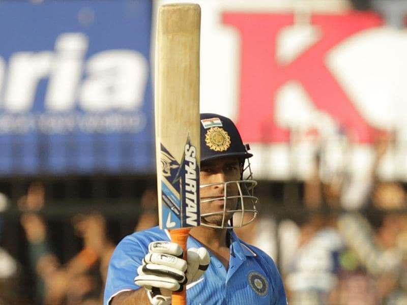 MS Dhoni celebrates his half century during India's first innings score of 247.  (Anshuman Poyrekar/HT Photo)