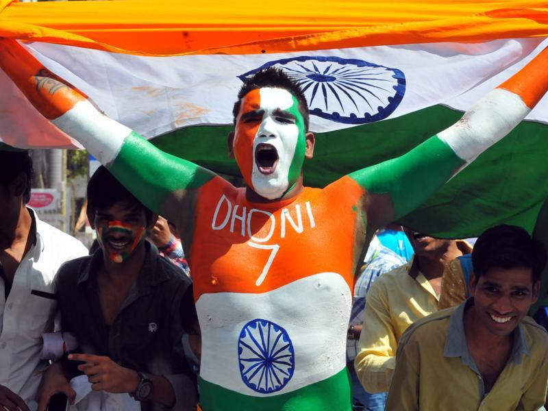 Cricket fans painted their face and body with the tricolour to support the Indian team. (Shankar Mourya/HT Photo)