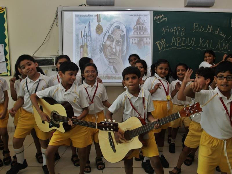 School students sing on the occasion of former President the late Dr APJ Abdul Kalam's birthday at Thane on Thursday.  (Praful Gangurde)