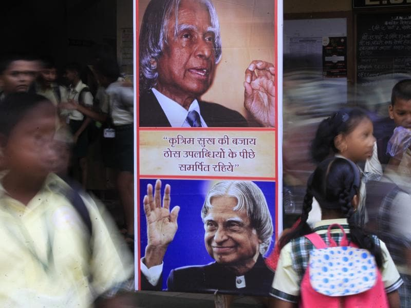 Students from a Vile Parle school walk past a banner highlighting an inspirational quote by Dr APJ Kalam, on Thursday.  (Satish Bate/HT photo)