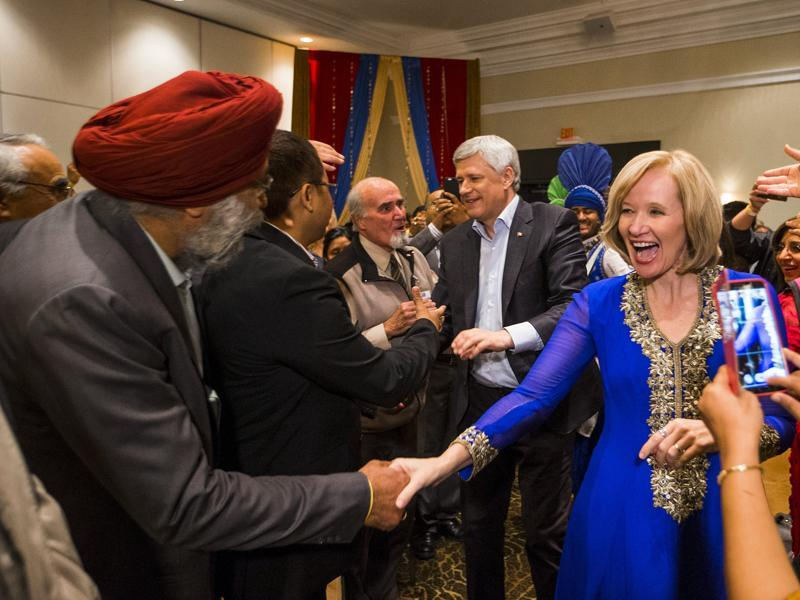 Canada's Prime Minister and Conservative leader Stephen Harper and his wife Laureen arrive at a rally with the South Asian community in Brampton. (REUTERS)