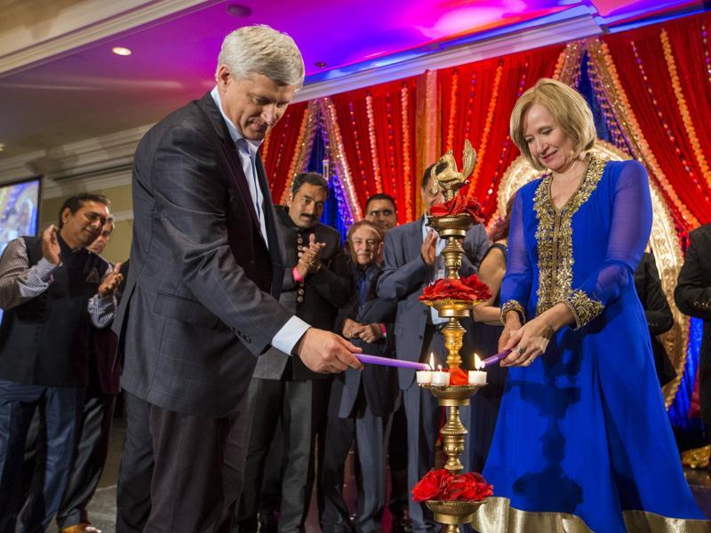 Canada's Prime Minister and Conservative leader Stephen Harper and wife Laureen light a