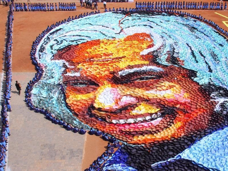 Indian school students surround a giant portrait of former President APJ Abdul Kalam as they celebrate his birth anniversary at a school in Chennai. (AP Photo)