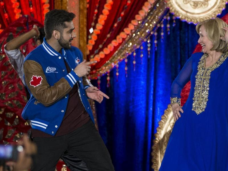 Laureen Harper, wife of Canada's Prime Minister and Conservative leader Stephen Harper, dances with actor Vinay Virmani (L) at a rally with the South Asian community in Brampton. (REUTERS)
