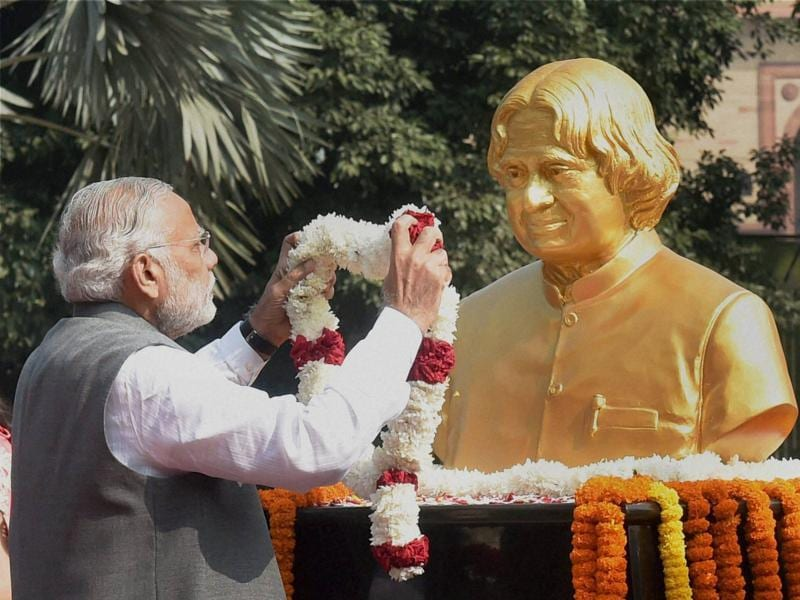 PM Narendra Modi pays tributes to former President APJ Abdul Kalam, on his 84th birth anniversary, at DRDO Bhawan in New Delhi. (PTI Photo)