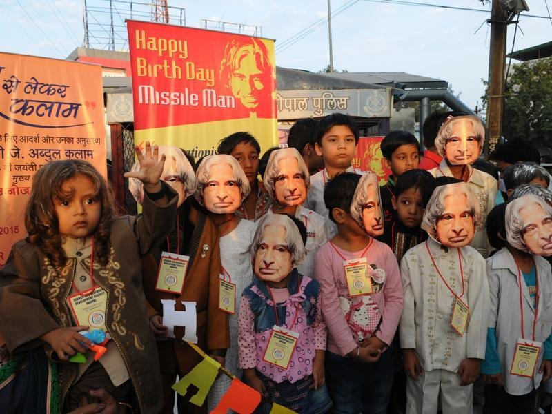 Children pay tribute to former President APJ Abdul Kalam on his birthday by wearing his mask during a programme organised by NGO Search and research development society in Bhopal. (Praveen Bajpai/Ht Photo)